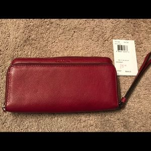 Crimson Coach wallet with wristlet strap.